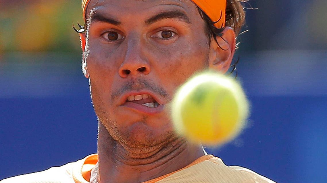 Spain's Rafael Nadal looks at the ball during his match against Philipp Kohlschreiber from Germany at the Barcelona open tennis tournament in Barcelona, Spain, Saturday, April 23, 2016. (AP Photo/Manu Fernandez)