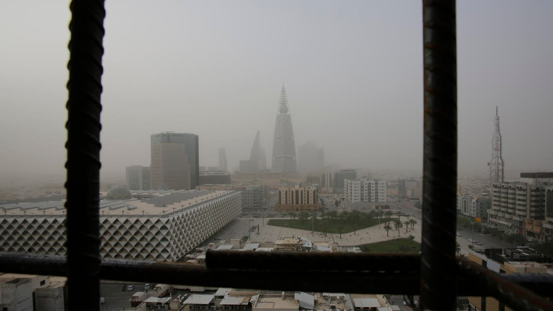 Al-Faisaliya tower is seen through metal bars from a nearby building under construction, during a sand storm in Riyadh, Saudi Arabia, Friday, April 25, 2015. (AP)