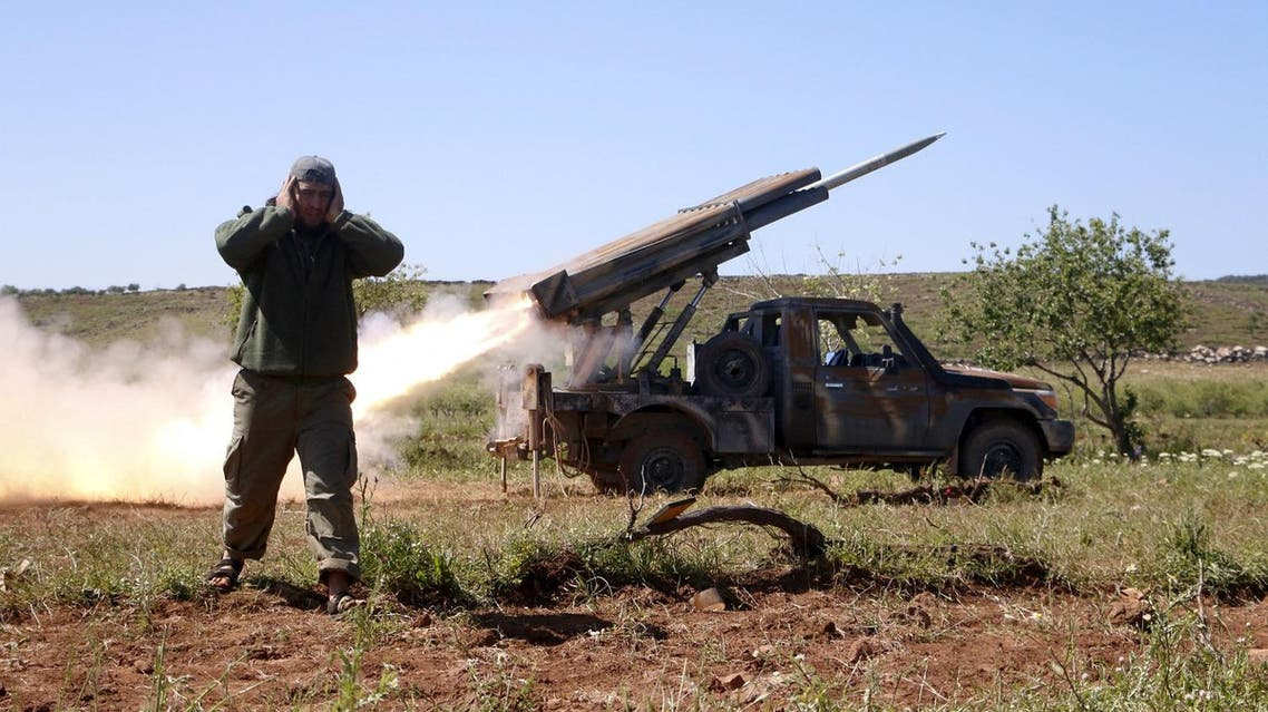 A rebel fighter from the Ahrar al-Sham Islamic Movement reacts as they fire grad rockets from Idlib countryside, towards forces loyal to Syria's President Bashar al-Assad stationed at Jureen town in al-Ghab plain in the Hama countryside, April 25, 2015. The Ahrar al-Sham Islamic Movement is participating in an operation providing backup support for fellow rebel fighters in Jisr al-Shughour after they took control of the area. Islamist insurgents including al-Qaeda's wing in Syria Nusra Front on Saturday captured large parts of the northwestern Syrian town of Jisr al-Shughour for the first time in the four year conflict. Syrian activists and a violence monitoring group said that fighters have pushed inside the town which lies on a road between the coastal city of Latakia and Syria's second city of Aleppo, after days of heavy fighting. REUTERS