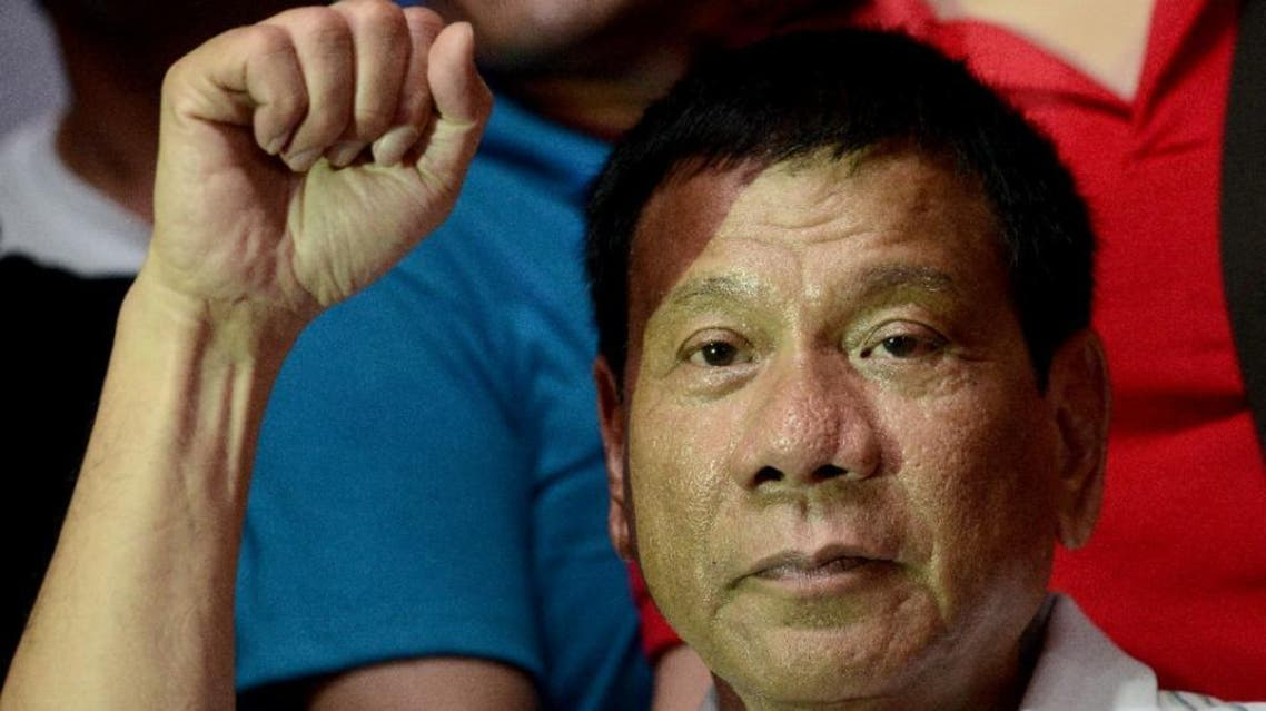 Philippine presidential front-runner candidate Rodrigo Duterte gestures during a campaign in Manila on April 23, 2016 (AFP)