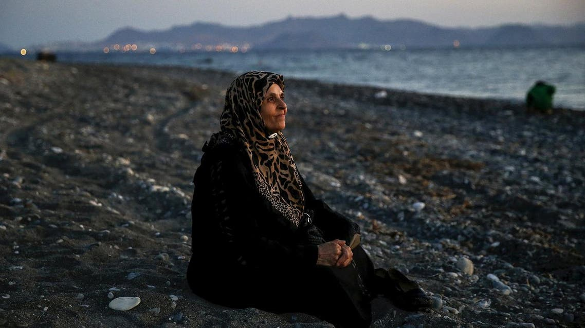 Amoun, 70, a blind Palestinian refugee who lived in the town of Aleppo in Syria, rests on a beach moments after arriving along with another forty on a dinghy in the Greek island of Kos, crossing a part of the Aegean Sea from Turkey to Greece, August 12, 2015. Reuters and The New York Times shared the Pulitzer Prize for breaking news photography for images of the migrant crisis in Europe and the Middle East. (Reuters)