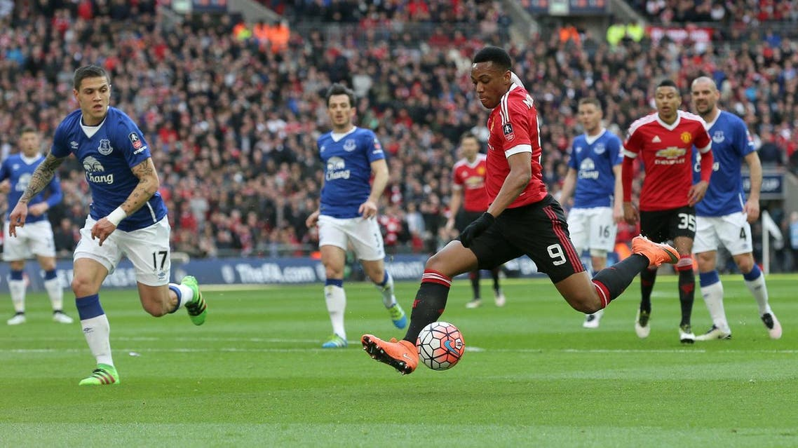 Manchester United's Anthony Martial, No 9, takes a shot on goal during the English FA Cup semifinal between Manchester United and Everton at Wembley in London, Saturday, April 23, 2016. (AP)