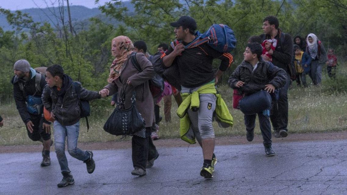 Syrian refugees cross a road while on the run in a forest in Macedonia after illegally crossing Greek-Macedonian border near the city of Gevgelija on April 23, 2016. (Reuters)