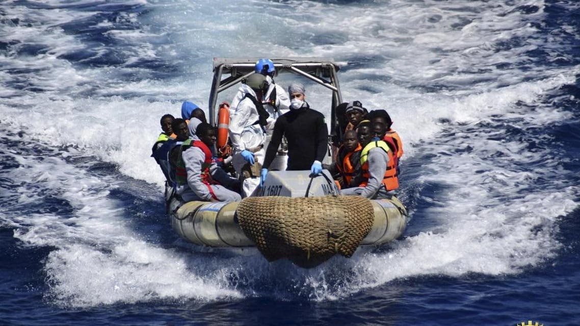 Migrants sit in a rescue boat during a rescue operation by Italian Navy vessels off the coast of Sicily in this April 11, 2016 (Reuters)
