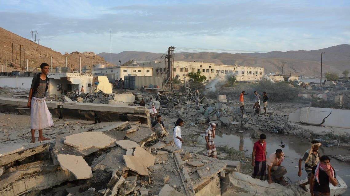 People inspect damage at a site hit by Saudi-led air strikes in the al Qaeda-held port of Mukalla city in southern Yemen. (Reuters)