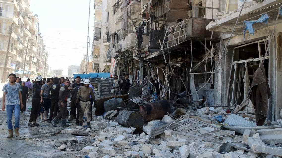 Residents and civil defence members inspect a damaged building after an airstrike on the rebel-held Tariq al-Bab neighbourhood of Aleppo. (Reuters)
