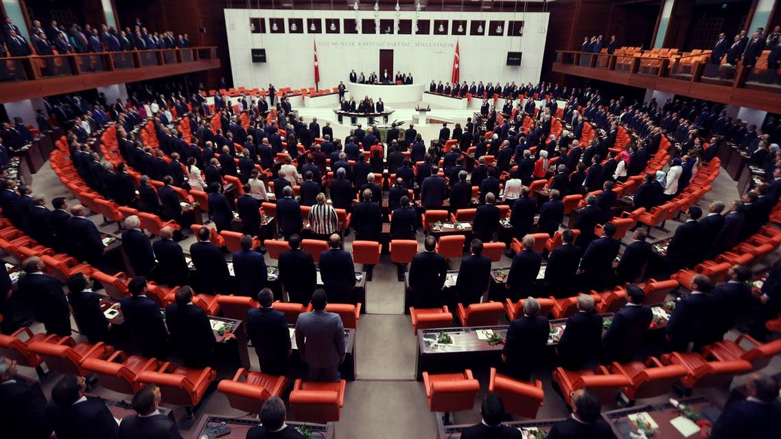 Newly elected legislators stand for national anthem before they take oaths during the Turkish parliament's first session in Ankara, Turkey, on Tuesday, June 23, 2015. The ruling Islamic-rooted Justice and Development Party (AKP) came out first in the June 7 elections but lost its parliamentary majority. (AP)