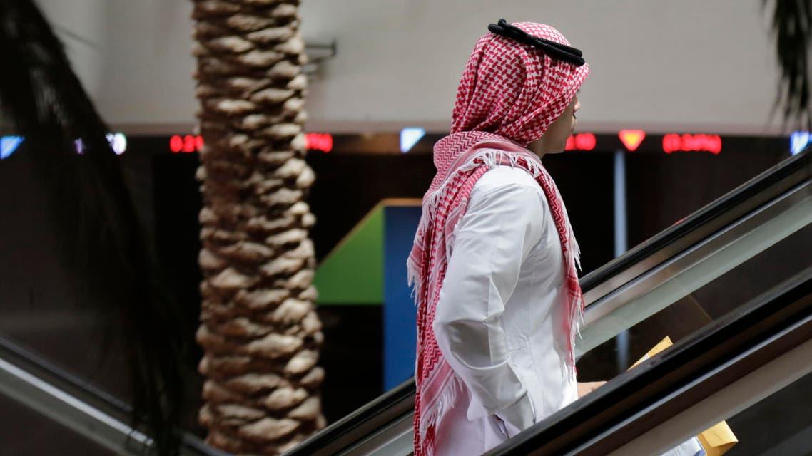 A Saudi man stands on an escalator at the Tadawul Saudi Stock Exchange, in Riyadh, Saudi Arabia, Monday, June 15, 2015. (AP)