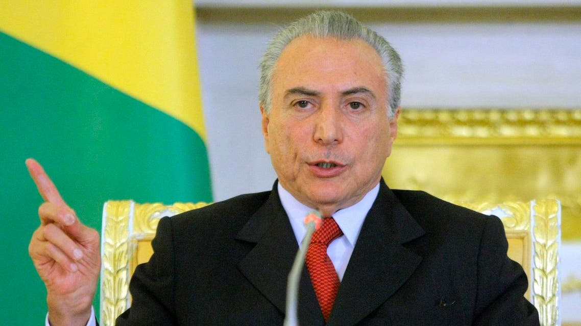 Brazilian Vice President Michel Temer gestures as speaks during the meeting with Russian Prime Minister Vladimir Putin in Moscow on Tuesday, May 17, 2011. (AP)
