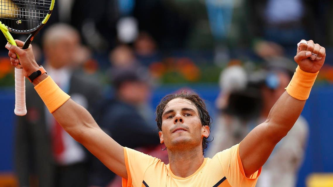 Rafa Nadal celebrates his victory over Fabio Fognini of Italy during the Barcelona open tennis tournament in Barcelona, Spain, Friday, April 22, 2016. (AP)