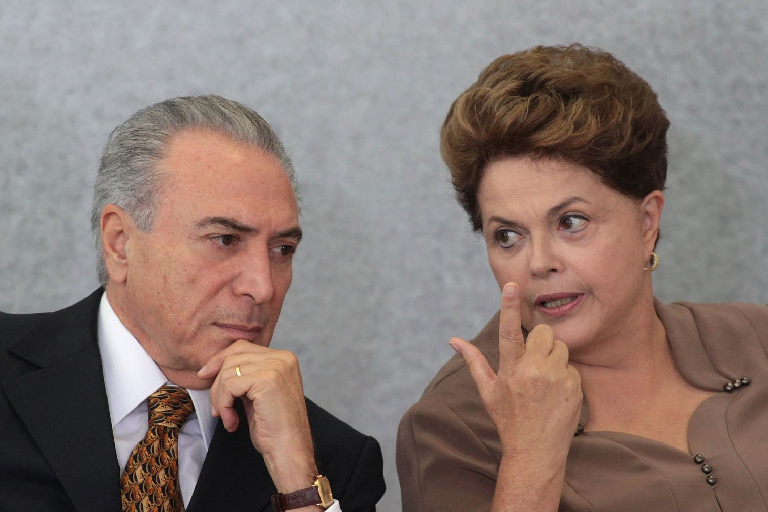 Brazil's President Dilma Rousseff, right, talks with her Vice President Michel Temer during a ceremony at Planalto Palace in Brasilia, Brazil. (AP)