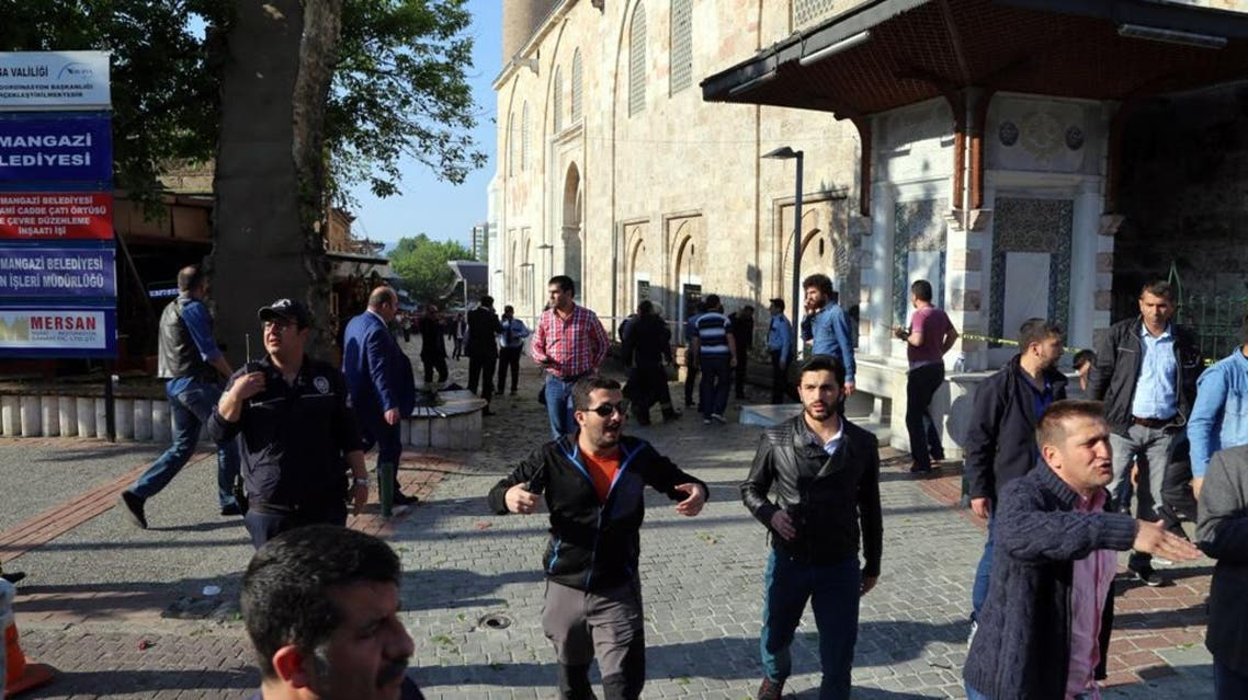 Security officials secure the area after an explosion outside the historical Ulu Cami in Bursa, Turkey, Wednesday, April 27, 2016. Turkish officials say a suicide attack has hit the northwestern city of Bursa, a popular tourist destination. A security official told The Associated Press the attack Wednesday was carried out by suicide bomber. (IHA agency via AP )