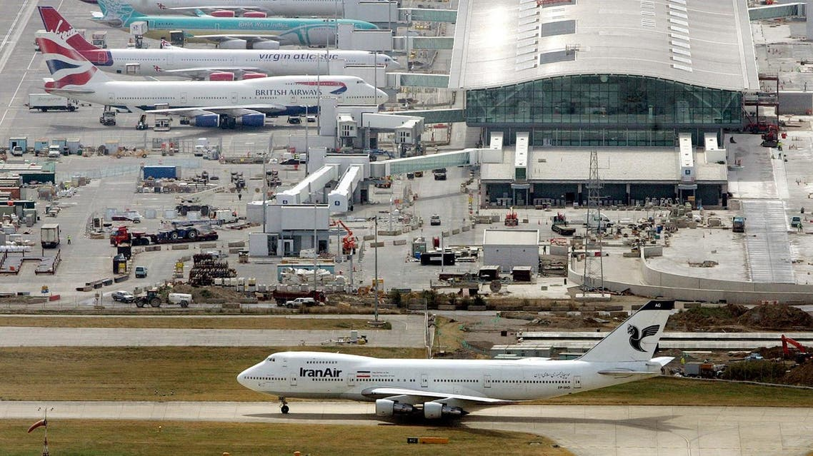 Airplanes sit at stands at terminal five at Heathrow Airport in London, Thursday Aug. 10, 2006. British authorities thwarted a terrorist plot to blow up several aircraft in flight between the United States and the United Kingdom using explosives smuggled in hand luggage, officials said Thursday. (AP Photo/Toby Melville, Pool)