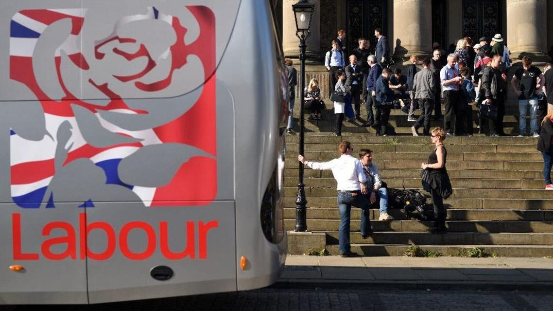 Labour Party supporters and members of the media wait on the steps of Leeds Town Hall, prior to attending a rally in Leeds. (AFP)