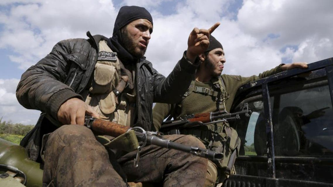 Ahrar al-Sham fighters gesture as they ride a pickup on the frontline of Idlib city in northern Syria. (Reuters)