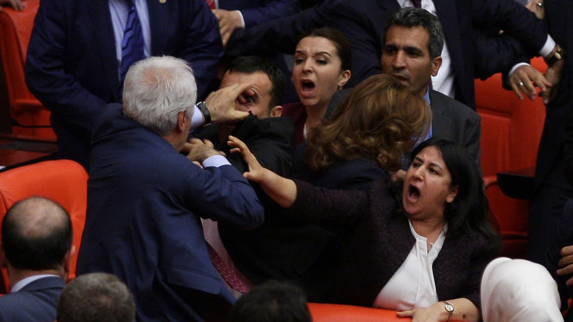Ruling AK Party and pro-Kurdish Peoples' Democratic Party (HDP) lawmakers scuffle during a debate at the Parliament in Ankara, Turkey late April 27, 2016. (Reuters)