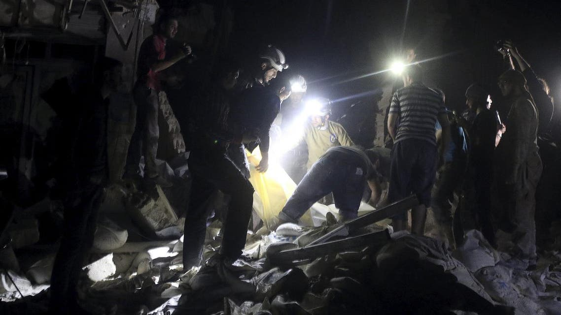 Civil defence members search for survivors after an airstrike at a field hospital in the rebel held area of al-Sukari district of Aleppo. (Reuters)