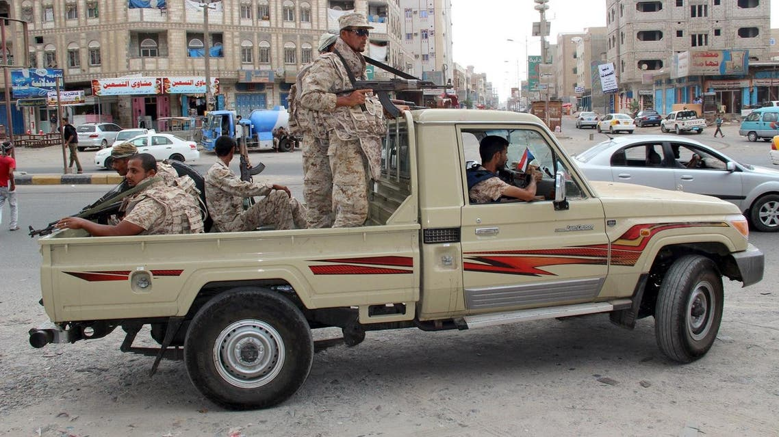 Yemeni army soldiers patrol a street in Mansoura district of Yemen's southern port city of Aden. (Reuters)