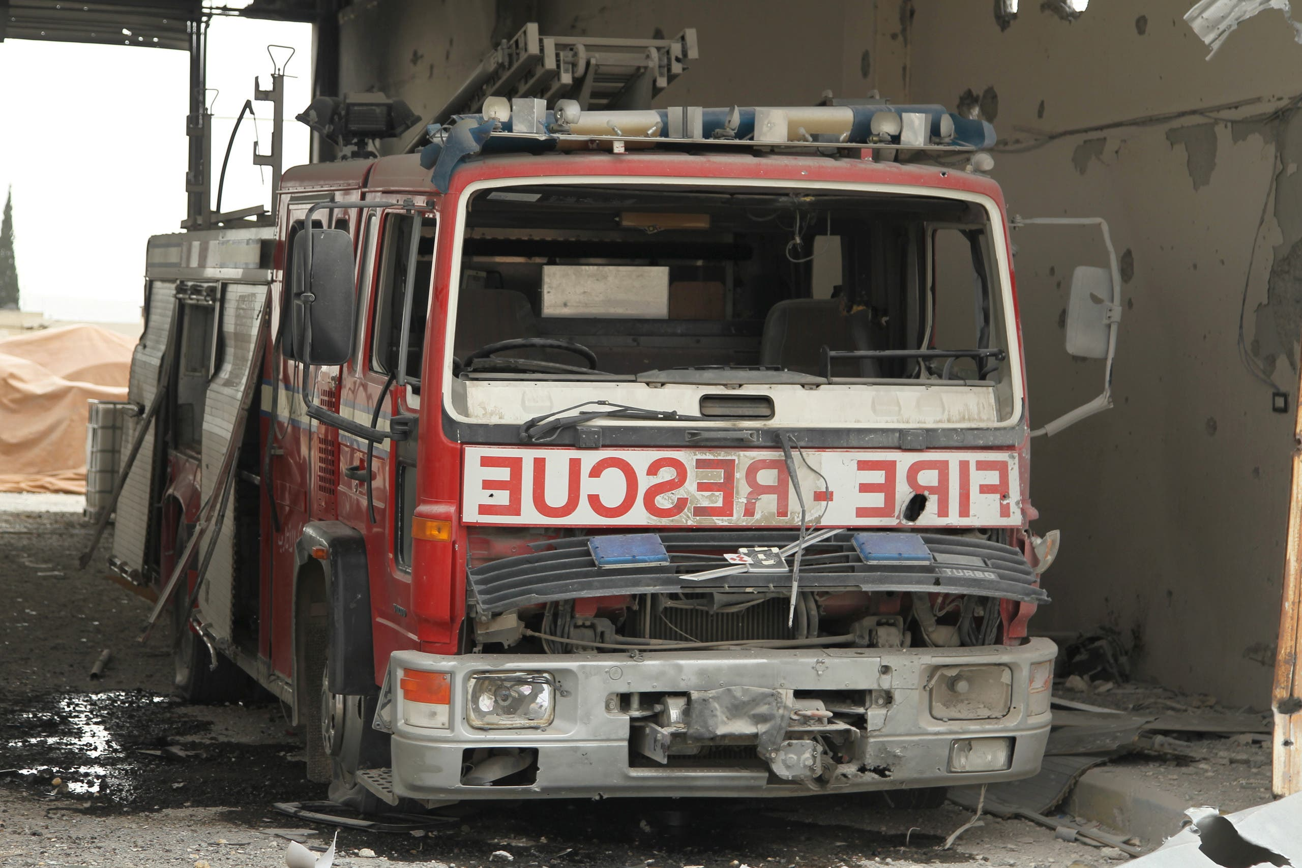 A damaged Civil Defence truck is pictured inside a rescue station in the rebel held town of Atareb, Aleppo countryside, Syria