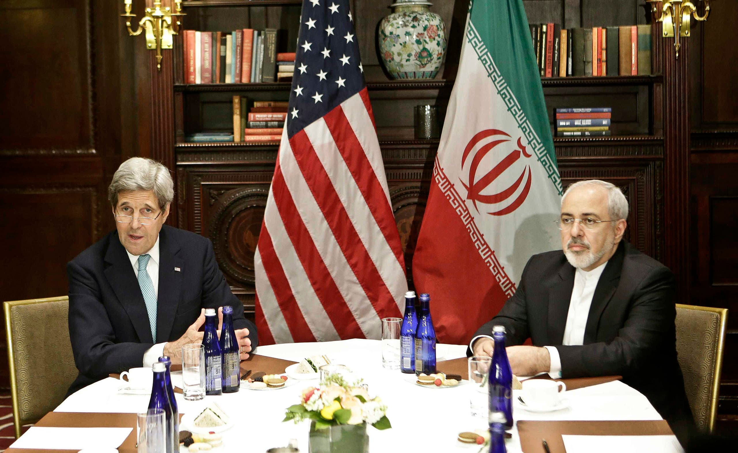Then-US Secretary of State John Kerry, left, meets with Iranian Foreign Minister Mohammad Javad Zarif on April 22, 2016, in New York. (AP)