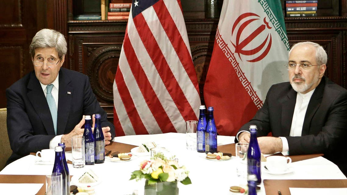 US Secretary of State John Kerry, left, speaks to the media as he meets with Iranian Foreign Minister Mohammad Javad Zarif Friday, April 22, 2016, in New York. (AP)