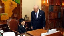 Seat of power: Tunisian president allows sick boy to sit on his chair