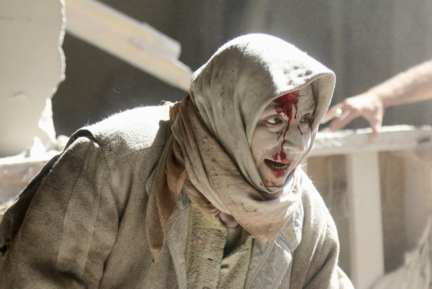 An injured woman reacts at a site hit by airstrikes in the rebel held area of Old Aleppo. (Reuters)
