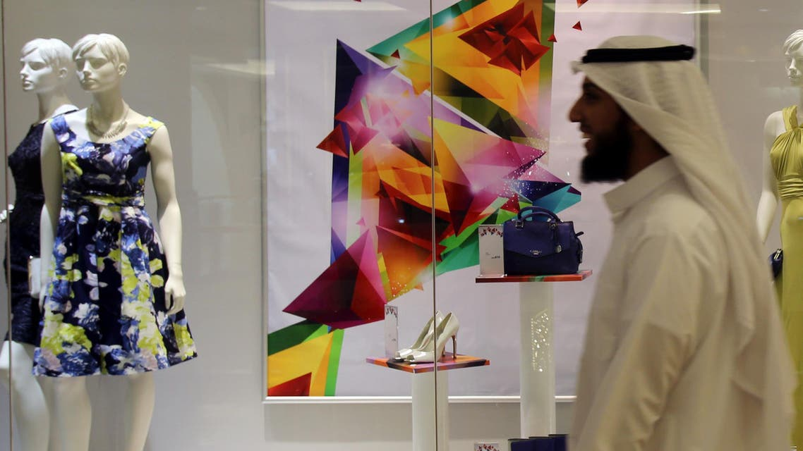 An Arab man passes by a fashion store decorated for the holy month of Ramadan in Dubai, United Arab Emirates.  (File photo: AP)