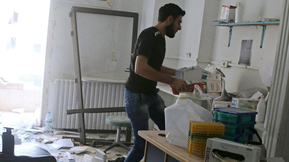 A man removes medicine inside al-Quds hospital after it was hit by airstrikes, in a rebel-held area of Syria. Reuters