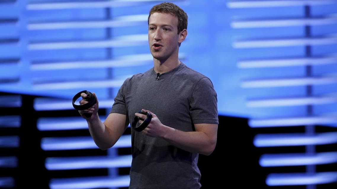 Facebook CEO Mark Zuckerberg holds a pair of the touch controllers for the Oculus Rift virtual reality headsets on stage during the Facebook F8 conference in San Francisco, California April 12, 2016. REUTERS
