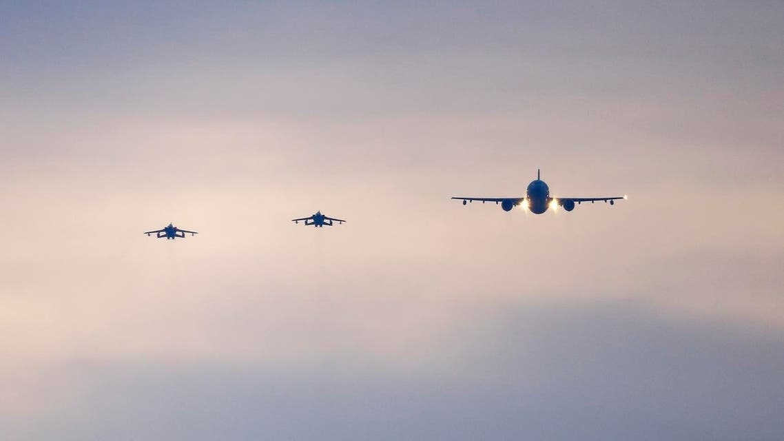 German air force Tornado jets and a cargo aircraft approach to land at an airbase in Incirlik, Turkey, December 10, 2015. The first the German air force Tornado reconnaissance jets will take off for Turkey's Incirlik air base on Thursday, to support the military campaign against Islamic State. REUTERS