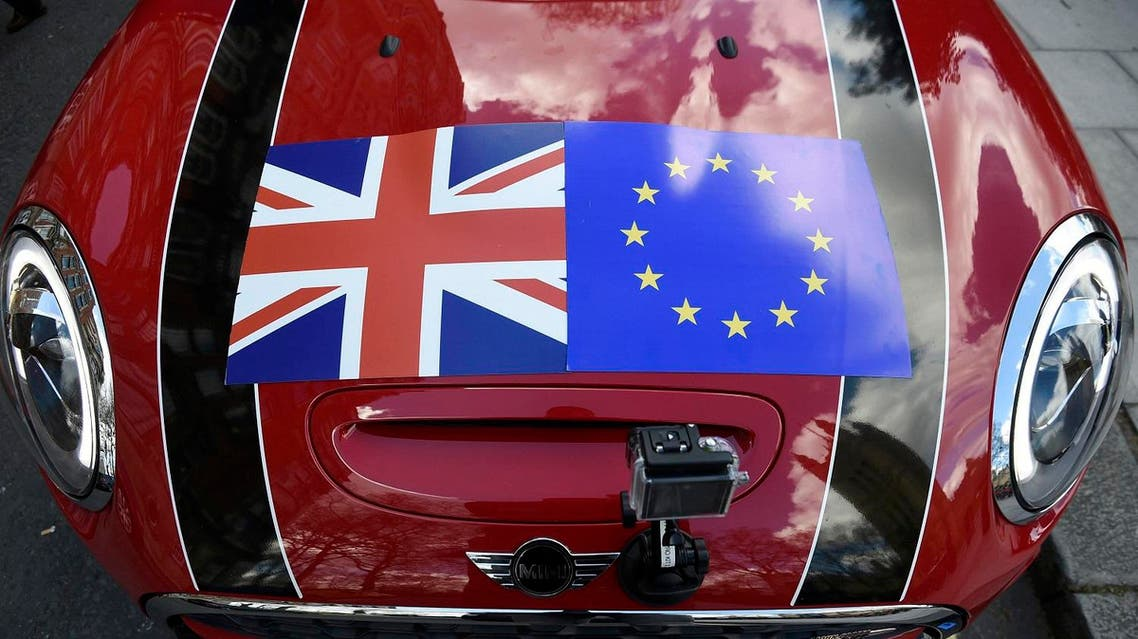 A Mini car is seen with a Union flag and European Union flag design on its bonnet in London, Britain March 31, 2016. REUTERS