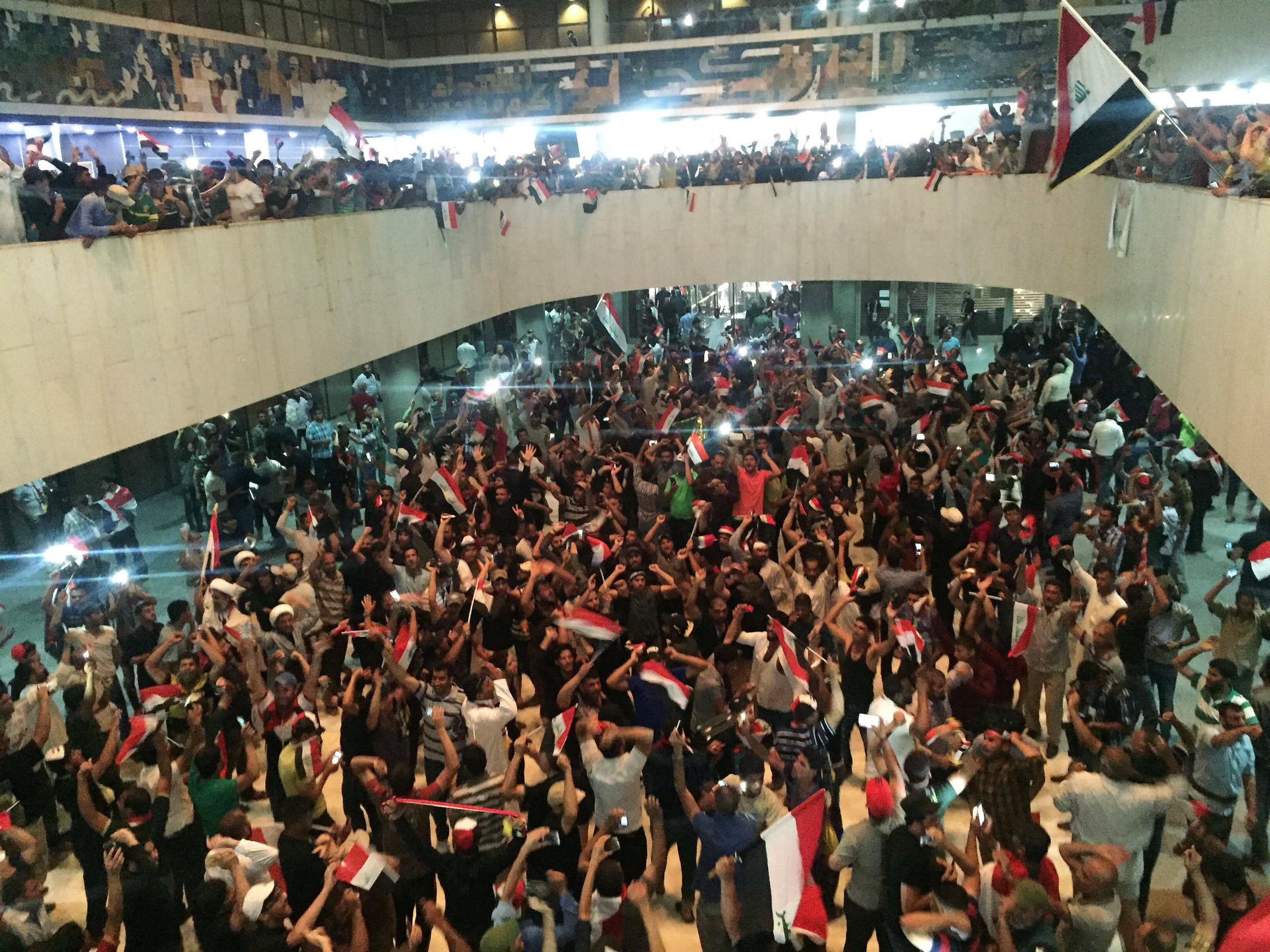 Followers of Iraq's Shiite cleric Moqtada al-Sadr are seen in the parliament building as they storm Baghdad's Green Zone after lawmakers failed to convene for a vote on overhauling the government, in Iraq April 30, 2016. (Reuters)