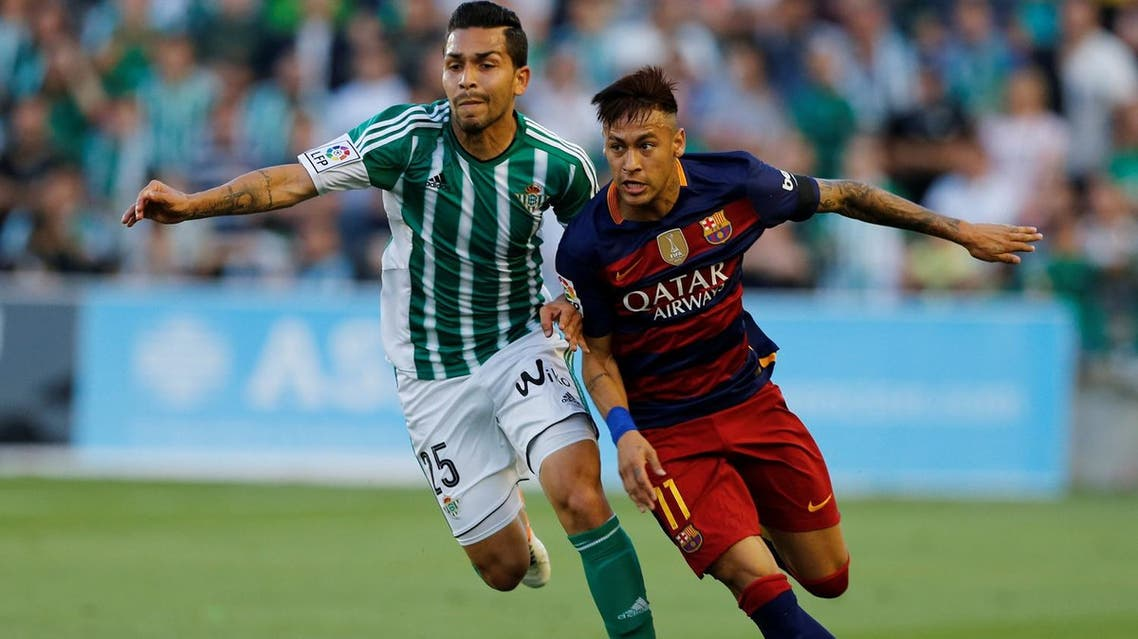 Barcelona's Neymar and Real Betis' Petros Araujo in action.