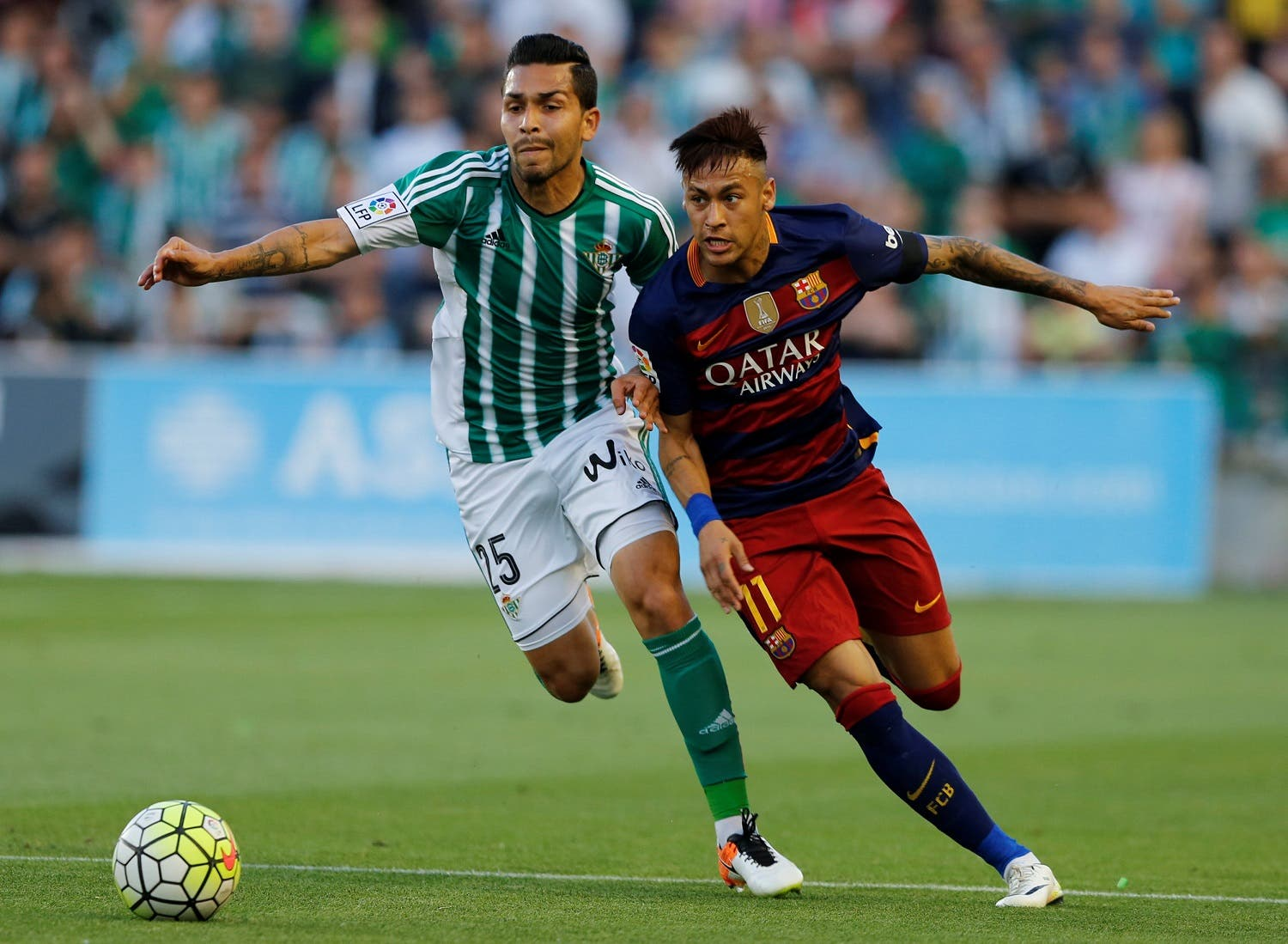 Barcelona's Neymar and Real Betis' Petros Araujo in action. REUTERS