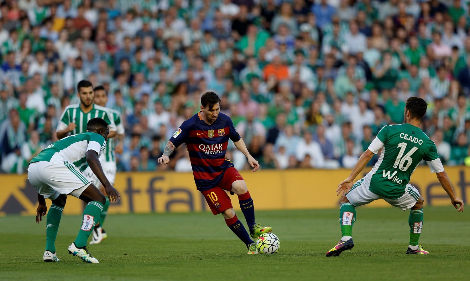 Barcelona's Leo Messi in action between Real Betis' players. REUTERS