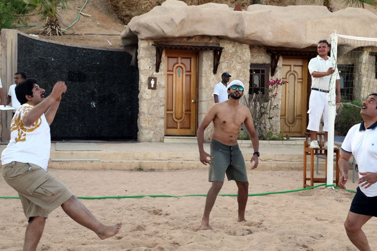 King Hamad and his family playing beach volleyball. (BNA)