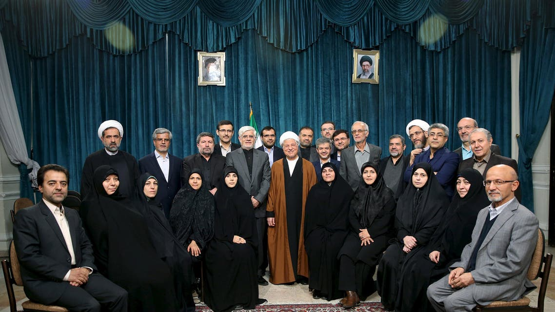Iran's former president Ali Akbar Hashemi Rafsanjani (C), Iranian former vice president Mohammad Reza Aref (centre, L) and a group of reformists pose for a photo in Tehran February 22, 2016. (Reuters)