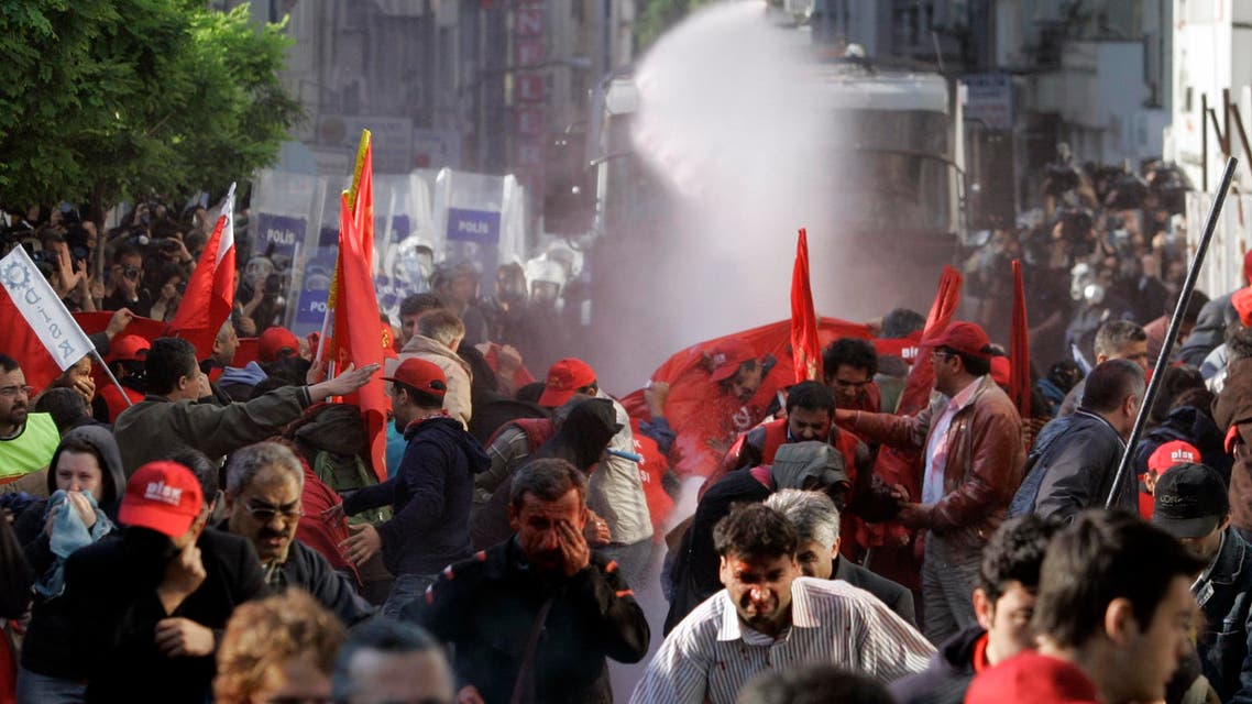 Riot police use water cannon and tear gas to desperse workers during a Labor Day demonstration in Istanbul, Turkey, Thursday, May 1, 2008. (AP)