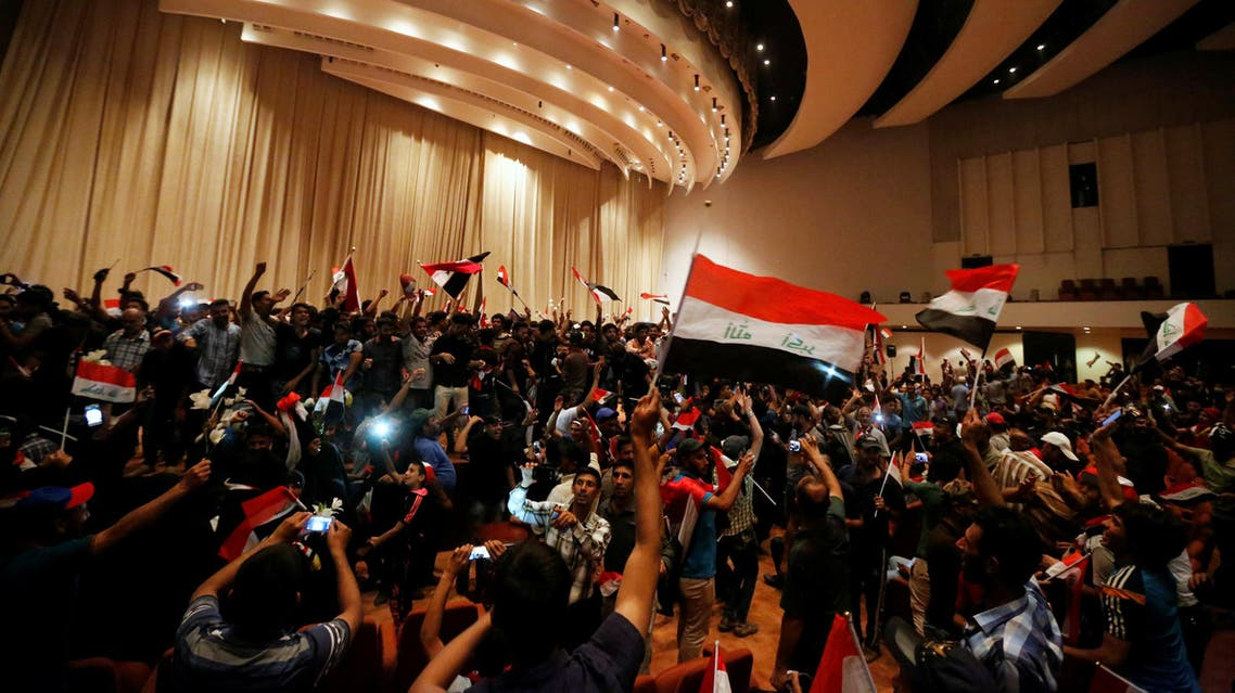 Followers of Iraq's Shi'ite cleric Moqtada al-Sadr are seen in the parliament building as they storm Baghdad's Green Zone after lawmakers failed to convene for a vote on overhauling the government, in Iraq April 30, 2016