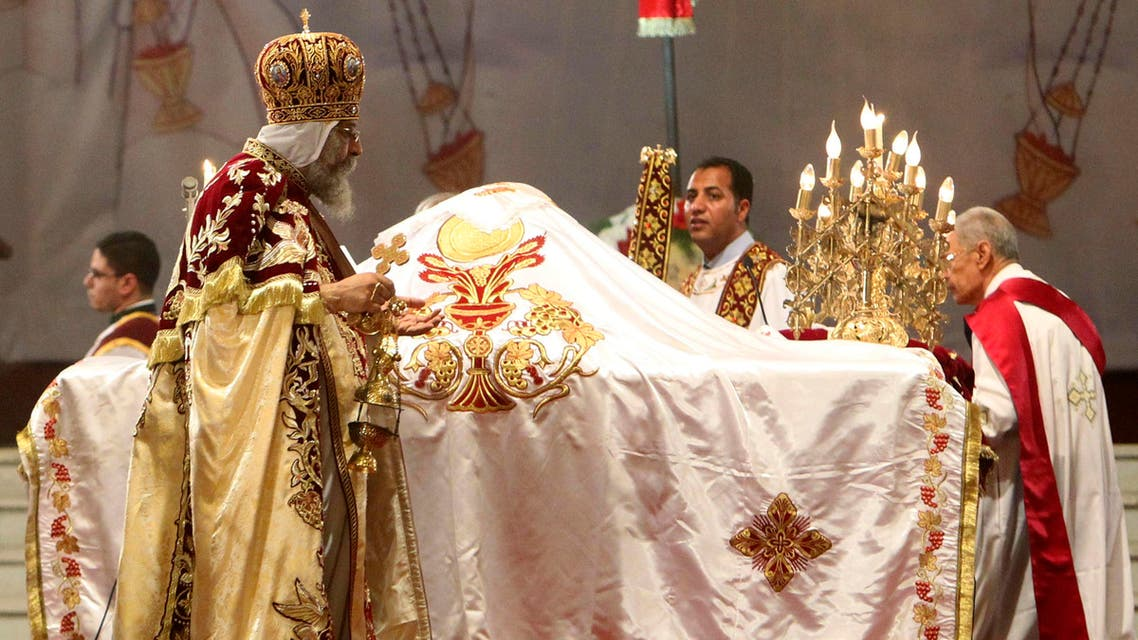 Coptic Pope Tawadros II (L), head of the Coptic Orthodox church, Coptic Christians and other priests take part in a ritual as part of a Coptic Orthodox Easter mass at the main cathedral in Cairo May 4, 2013. (Reuters)