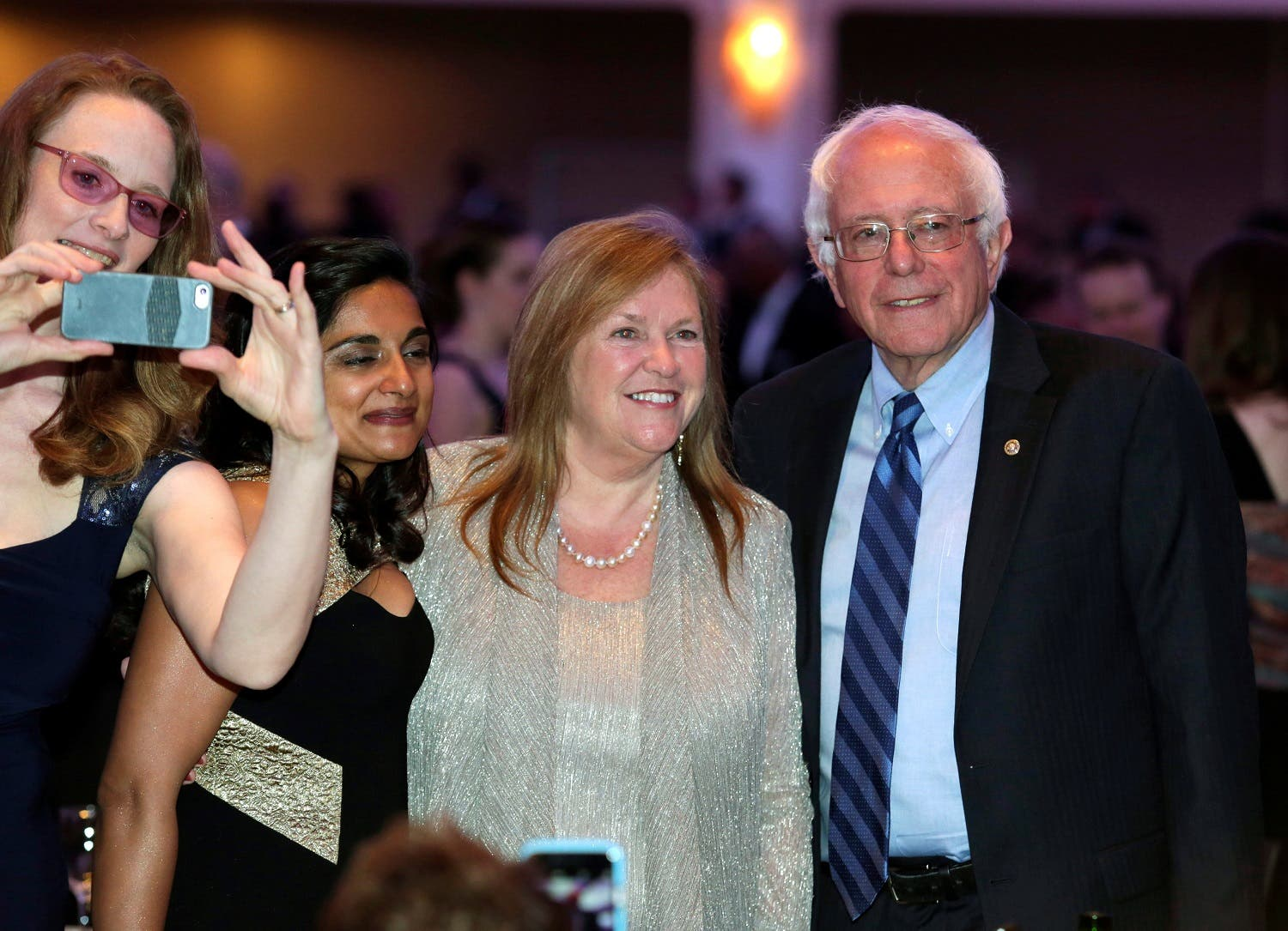 Democratic U.S. presidential candidate Bernie Sanders and his wife Jane (2nd R) attend the White House Correspondents' Association annual dinner in Washington, U.S. April 30, 2016. REUTERS