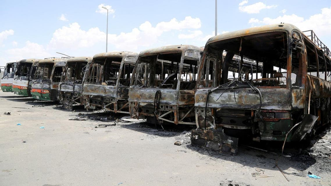 Buses, which witnesses said were burnt by workers from construction company Saudi Binladin Group in a protest over delayed wages, are seen in Mecca, Saudi Arabia May 1, 2016. REUTERS