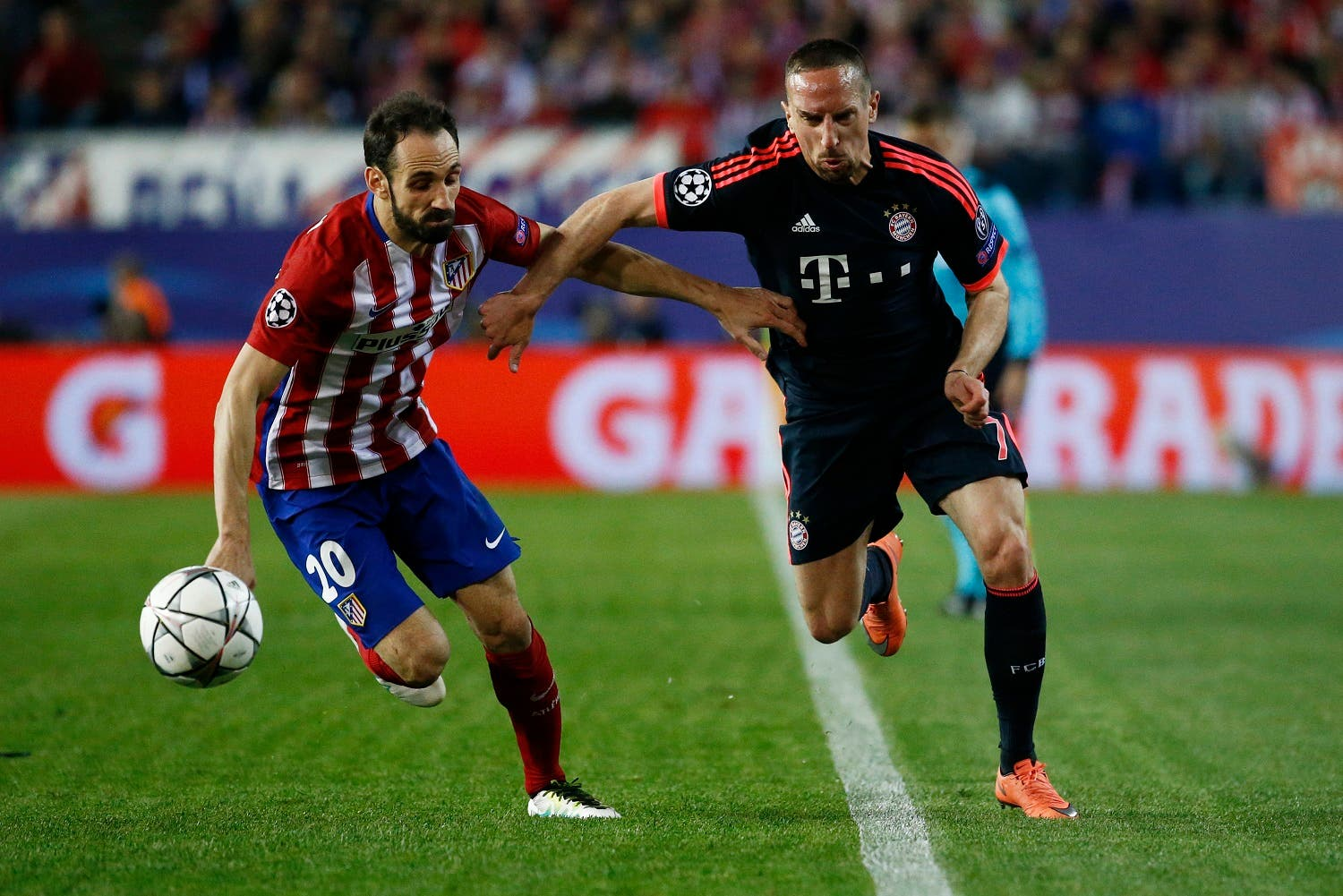 Bayern Munich's Franck Ribery in action with Atletico Madrid's Juanfran. (Reuters)