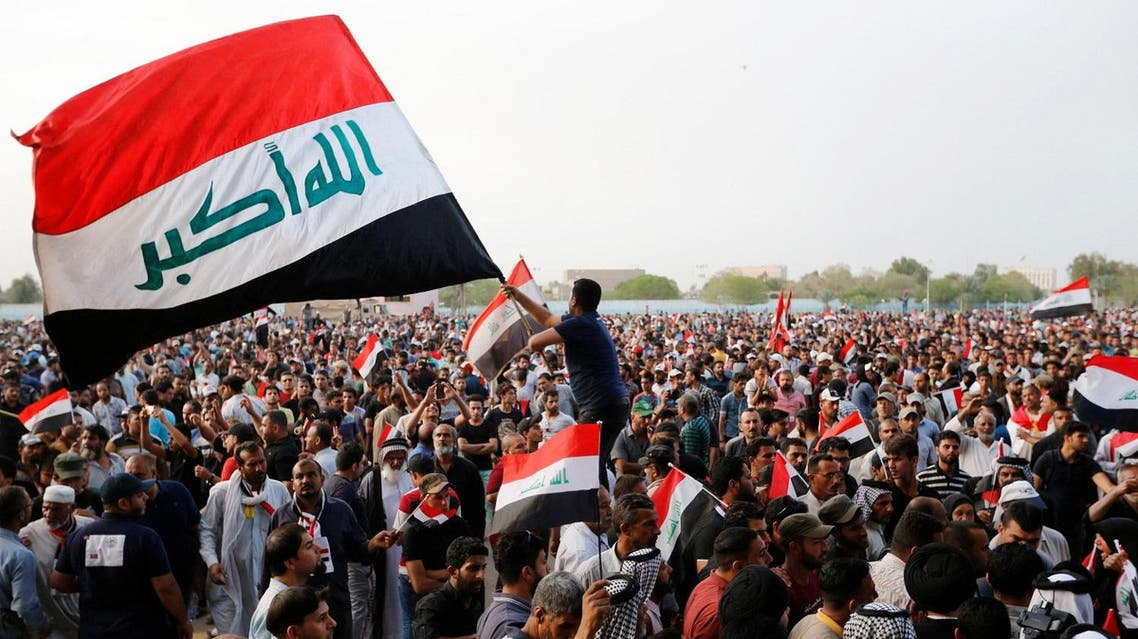 Loudspeakers manned by followers of Shiite cleric Muqtada al-Sadr announced the disbanding of the protests. (Reuters)
