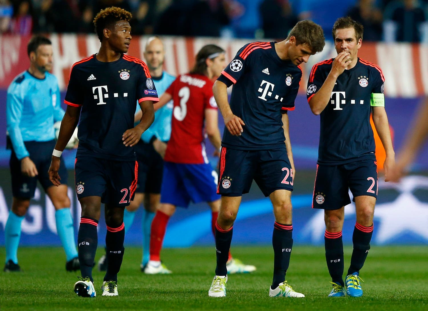 Bayern Munich's David Alaba, Thomas Muller and Philipp Lahm look dejected at the end of the match. (Reuters)