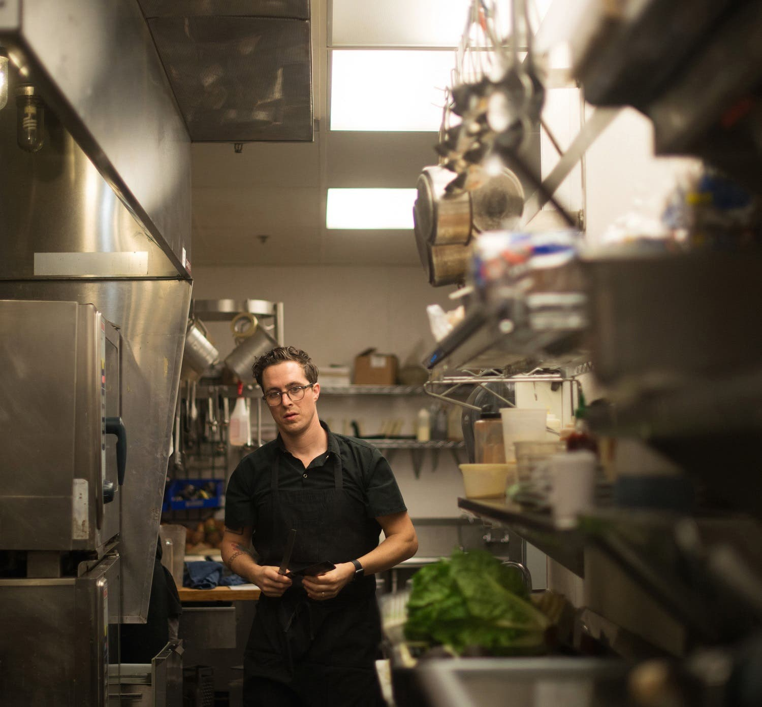 """In this April 30, 2016 photo, chef Ray Roberts, who runs multiple Peoples Organic restaurants with his wife in the Twin Cities, prepares meals at his Edina, Minn., location. Roberts was the personal chef for music megastar Prince until he was found dead on April 21, 2016. """"It felt like he wasn't himself probably the last month or two,"""" Roberts said. """"I think he was just struggling with being sick a lot."""" (AP)"""