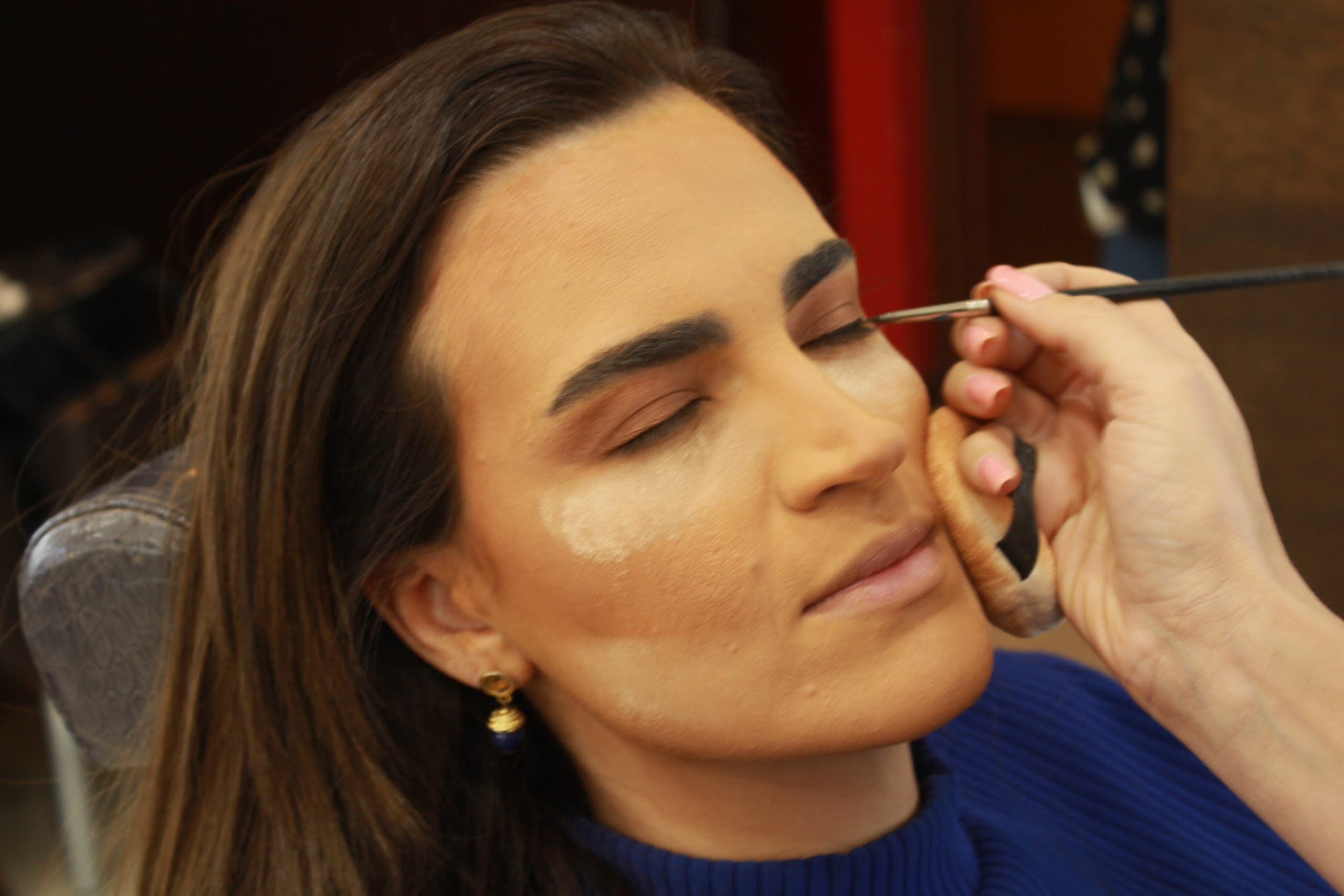 Al Arabiya's business anchor Rania Abi Nader getting her make-up done