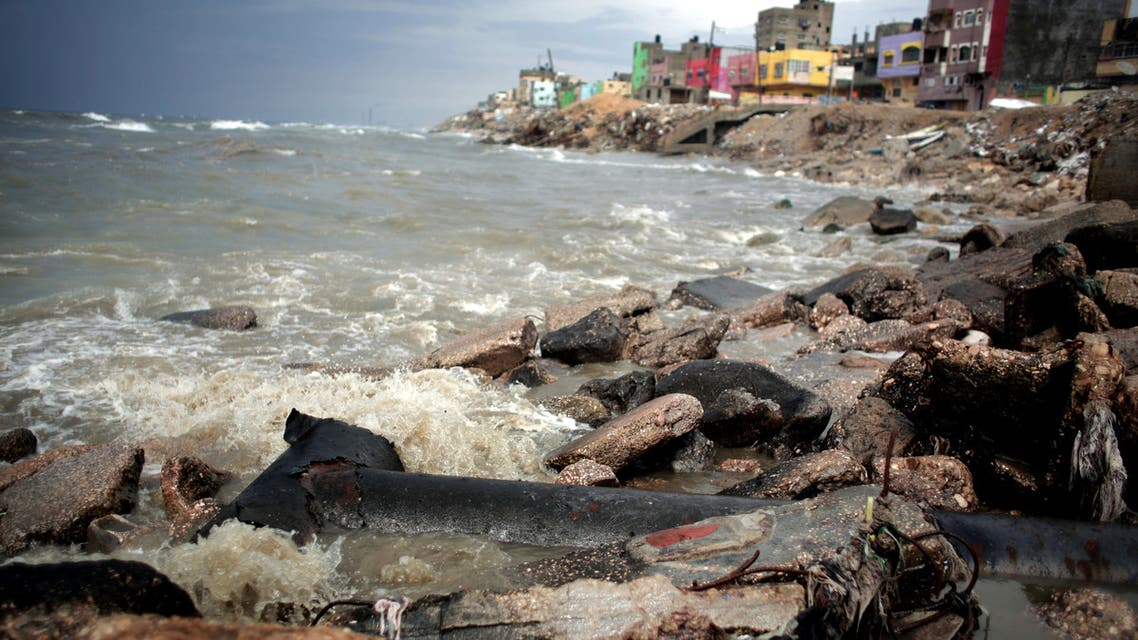 In this Tuesday, April 12, 2016 photo, Sewage flows from an outlet into the sea in front of Shati refugee camp in Gaza City. AP