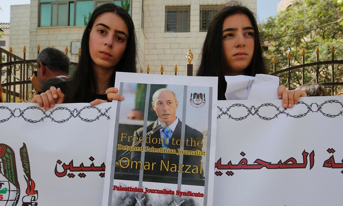 Palestinian journalists protest in support of their colleague Omar Nazzal after he was detained by Israeli forces. Photograph: Abbas Momani/AFP